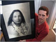 Picture of Stratford charcoal artist John A. Manley with one of his portraits recently custom-framed at My Custom Framer.